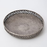 Torch cut and hammered shallow metal bowl by Marce
