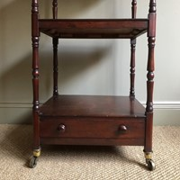 Smart late 19C mahogany Whatnot on castors