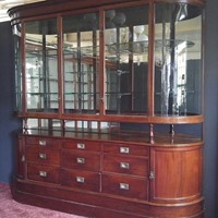 Antique glazed display cabinet with drawers