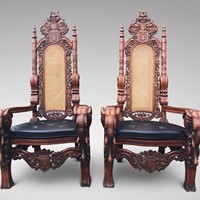 Pair of carved elephant throne chairs