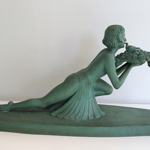 Art Deco terracotta woman with a bird. Marked