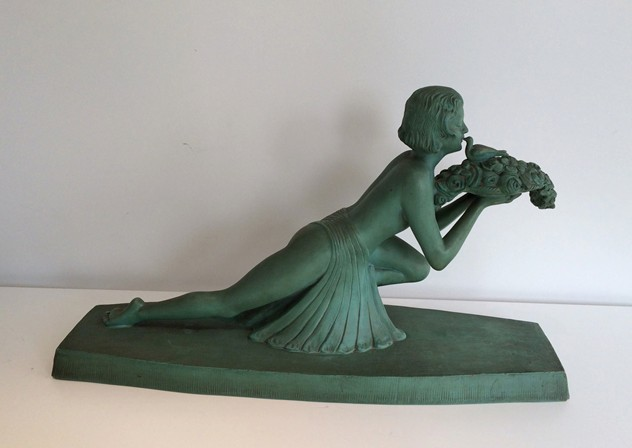 Art Deco terracotta woman with a bird. Marked-barrois-antiques-AD-576_main_636299178852896258.jpg