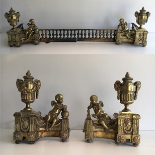 Beautiful chiseled bronze andirons with cherubs.
