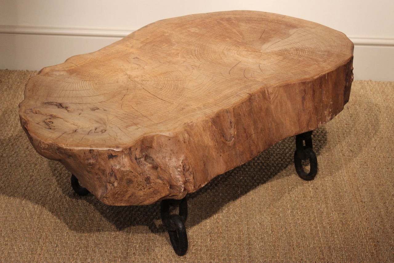 A sculptural wooden and cast iron coffee table for Cast iron coffee