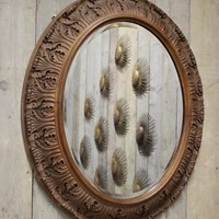 A 19th century Swedish Carved Oak Mirror
