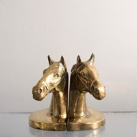 Pair of brass horse head bookends