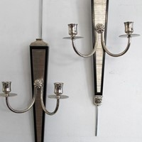 A set of 8 ebonised and nickel wall lights