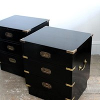 A pair of English ebonised side chests