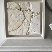 A contemporary plaster effect abstract picture