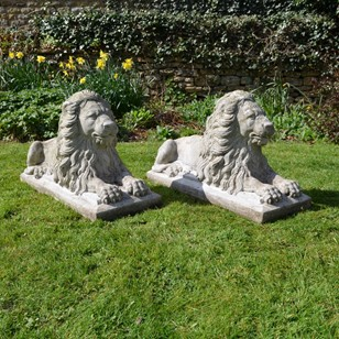 Pair of Recumbent Composition Lions