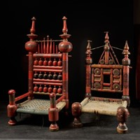 A pair of old Punjabi hand crafted wedding chairs