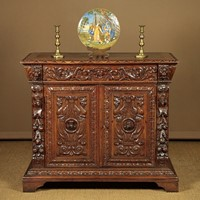 Renaissance Revival Carved Oak Chiffonier.