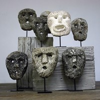 Collection of Fossillised coral animist Masks
