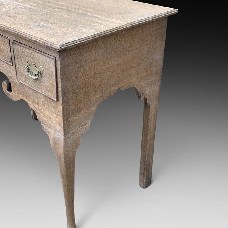 A Bleached Georgian Oak Lowboy-d-j-hicks-antique-furniture-752ce591-45a7-4963-a976-1f57208cecbb-main-637282483116911905.jpeg