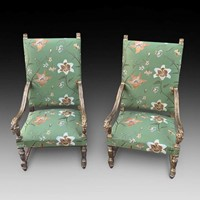 A Pair of Distressed Gilt Framed Armchairs