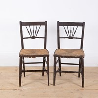 Pair of regency rush seated chairs.