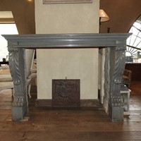 19th century grey limestone fireplace .