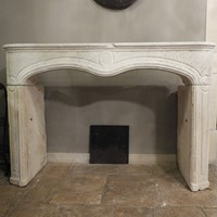 Antique Louis XV limestone fireplace