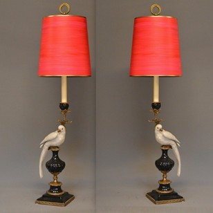 Pair ceramic parrot candle sticks as lamps.