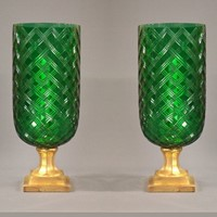 Pair of green glass hurricane lamps