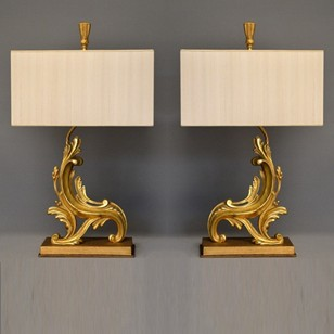 Pair of antique andirons as lamps.