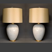 Pair of vintage creme glazed vases mounted as lamp