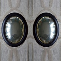 Pair of oval weathered convex mirrors