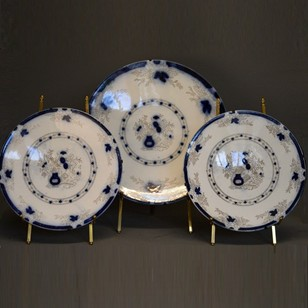 Three blue/white decorative chargers/plates
