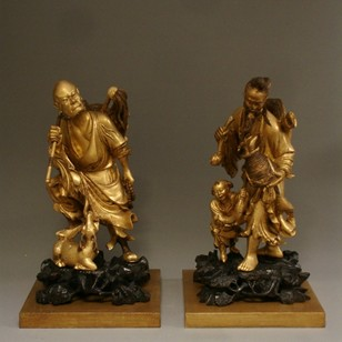 Pair of antique Chinese giltwood carvings.