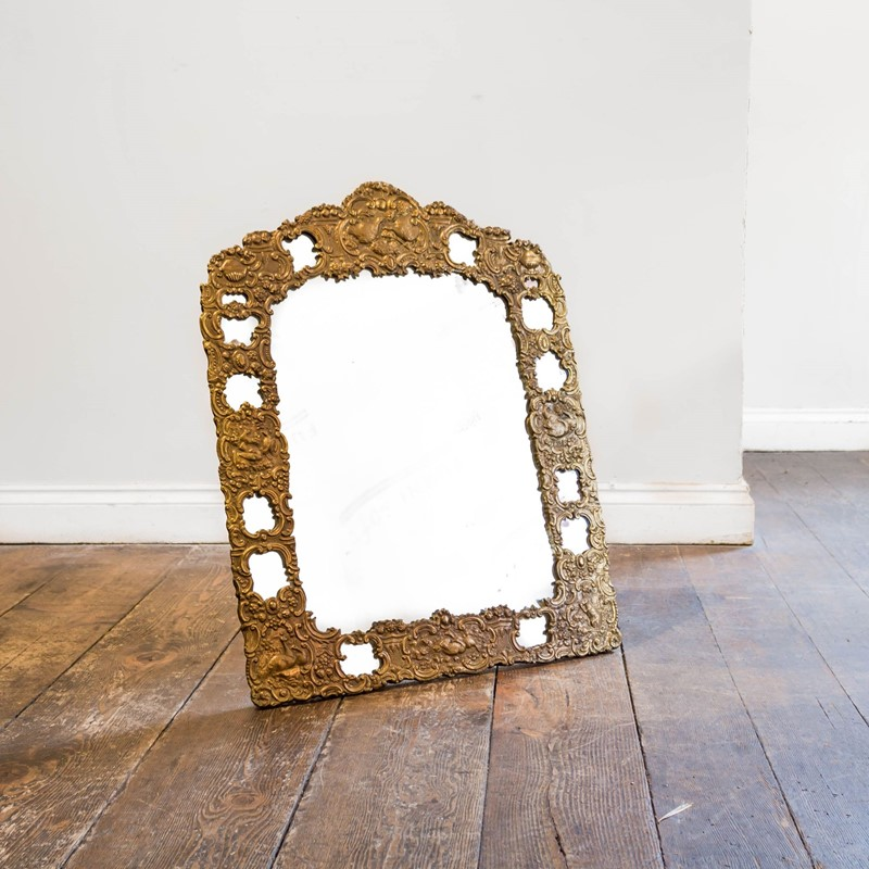 An unusual repousse gilt brass easel mirror-foster-and-gane-26210724883726707-main-637037281286714721.jpg