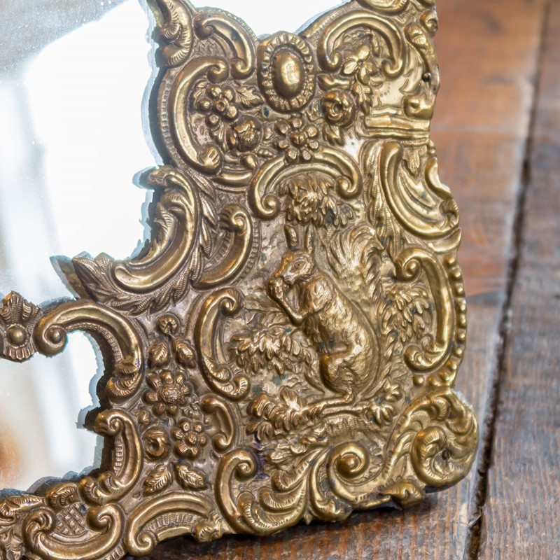 An unusual repousse gilt brass easel mirror-foster-and-gane-26210724883726710-main-637037281514057544.jpg