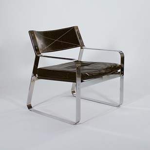Rare polished steel and black leather armchair