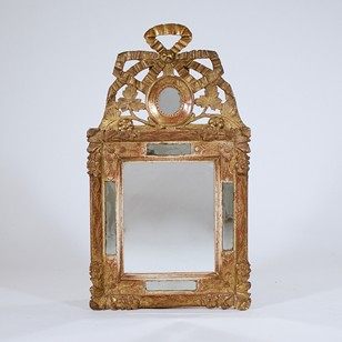 A Louis XVI carved giltwood mirror