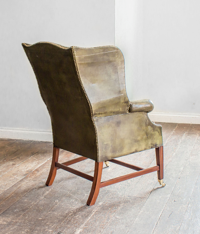 A Mahogany and green leather wing armchair-foster-and-gane-screenshot-2019-03-28-at-143542-main-636893807070641848.png
