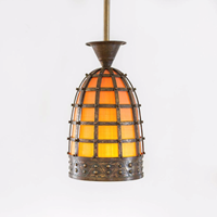An unusual hammered and riveted brass lantern