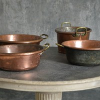 A collection of large 18th century copper pans