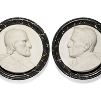 Pair of marble plaques with a Pope in profile