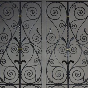 Pair large wrought iron/bronze antique grilles
