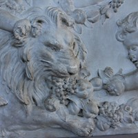 Plaster  plaque of cherubs and a lion
