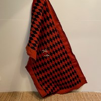 A Large Black and Red Wool Blanket
