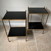 Pair of black vitrolite glass and brass side table