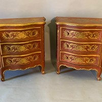 Pair of serpentine side cabinets