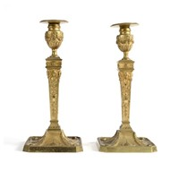 A pair of Ormolu Candlesticks