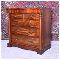 A large mahogany chest of drawers