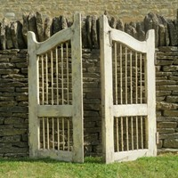 Pair of old painted decorative garden gates