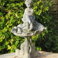 Small antique lead birdbath