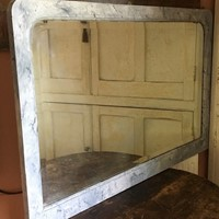 Faux marble overmantel mirror.