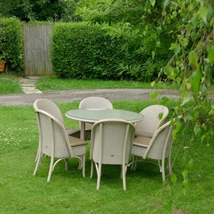 Four Lloyd Loom Chairs and Table