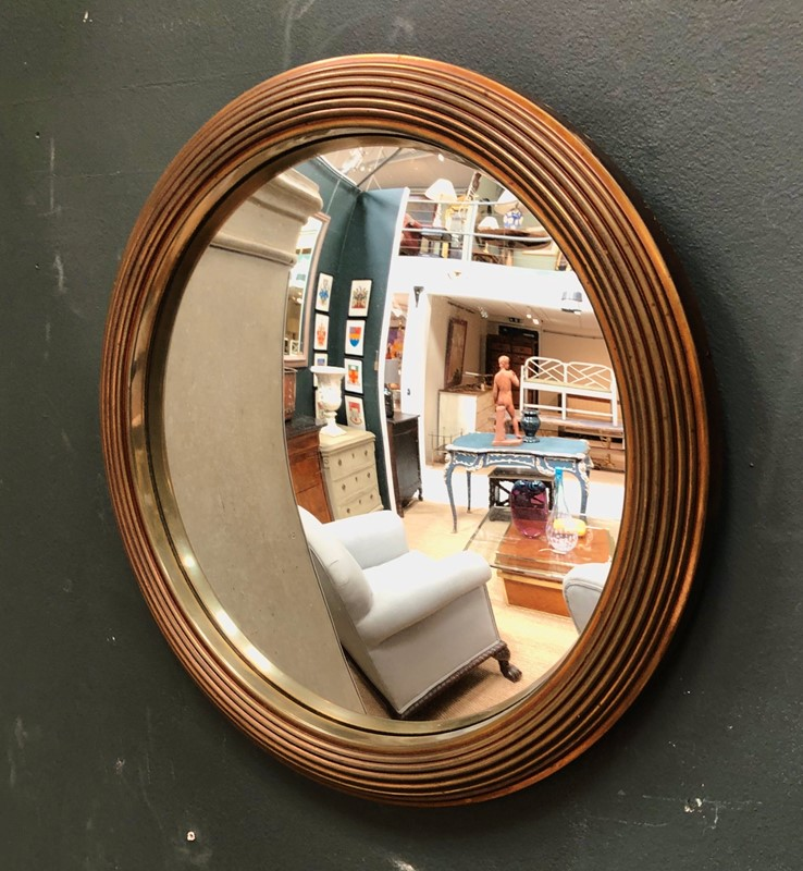 A brass framed convex mirror -marchand-antiques-091cd1cc-abf7-4009-aa67-47247c366693-main-637265329335681608.jpeg