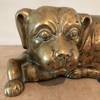 A cast brass Spaniel dog